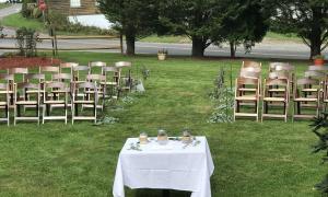 Ceremony on veranda lawn