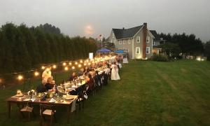 Rustic farm table reception on main lawn
